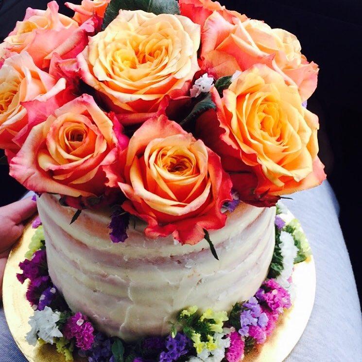 White ganache 50th Birthday cake for a mum who loves flowers.